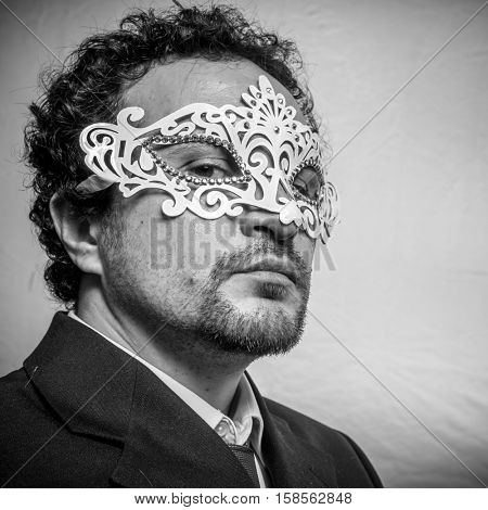 Identity, Sensual and mysterious businessman with white venetian mask