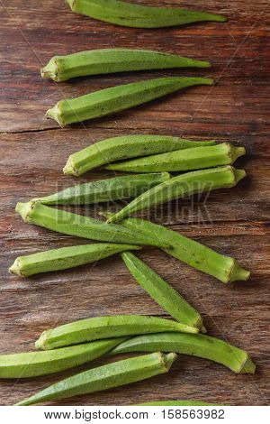 Lady Fingers Or Okra Over Wooden Table Background. .. Top View