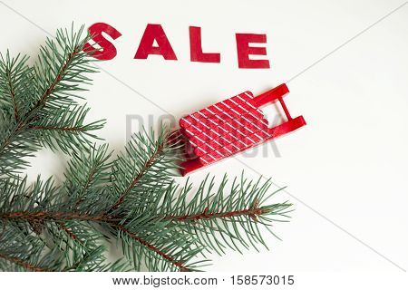 hot Sale on a rustic wooden isolated on white background. Christmas Gift. Copy space for text.