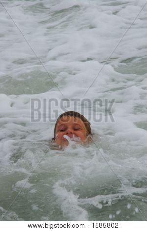 Boy In The Ocean Waves