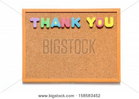 Wooden cork board with wording thank you on white background