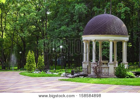 Rotunda with bridges in the park. Small architectural forms.