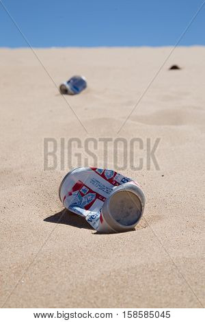 March 31 2016 Imperial Sand Dunes California USA. Beer cans litter the Glamis sand dunes near Yuma Arizona a favorite spot for dune buggies and ATVs that race through the dunes