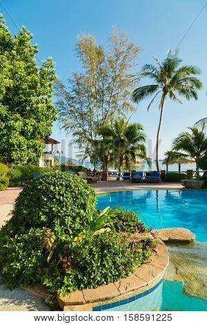 Fragment of blue water pool in smal Thai resort