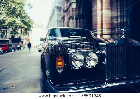 PARIS FRANCE - SEP 12 2016: Front view of Exclusive Luxury Rolls-Royce car limousine parked in city during fashion wedding vip event waiting for passenger. Rolls-Royce Limited is a British car-manufacturing and later aero-engine manufacturing company foun
