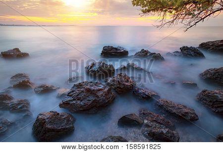 beautiful sun rising sky at sea beach with long exposure photography process