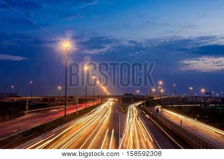 Motorway traffic at night with the lights of the car lights.
