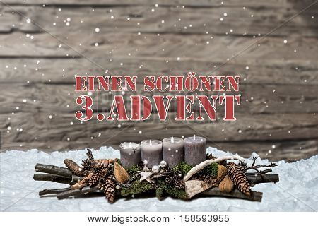 Merry Christmas decoration advent with burning grey candle Blurred background snow text message german 3rd