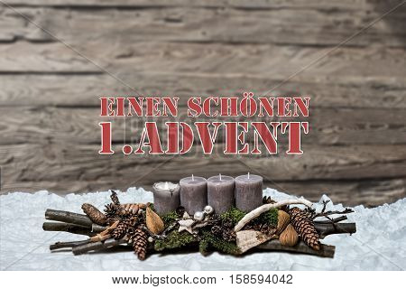 Merry Christmas decoration advent with burning grey candle Blurred background snow text message german 1st
