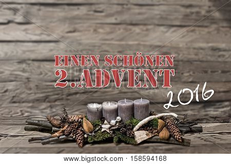 Merry Christmas decoration advent 2016 with burning grey candle Blurred background text message german 2nd