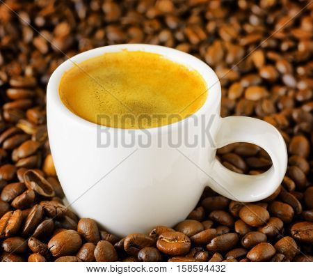Cup Of Espresso In Coffee Beans