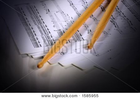 Drumstick With Music Sheet