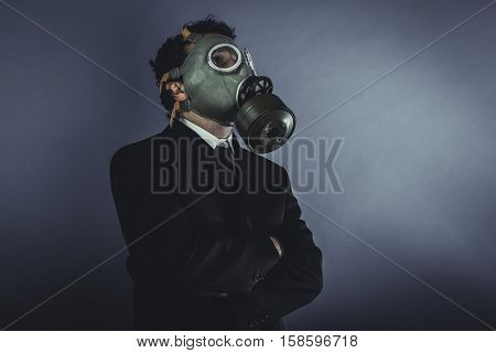 Toxic, Businessman with gas mask, concept business dangerous for the environment or for society