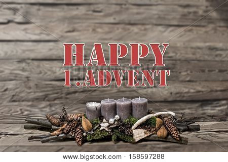 Merry Christmas decoration advent with burning grey candle Blurred background text message english 1st