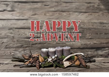 Merry Christmas decoration advent with burning grey candle Blurred background text message englisch 2nd
