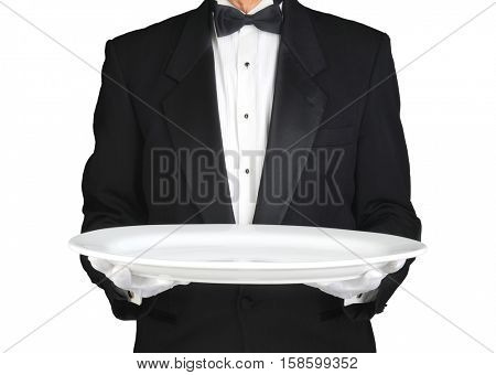 Waiter holding a large white platter over white. Horizontal format, man is unrecognizable.