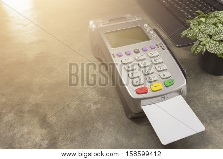 Credit Card Terminal Or Edc On Cashier Table In The Store ,  Credit Cards And Laptop On Cashier Tabl