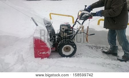 A man cleaning snow with snowblower, Siberia, Novosibirsk