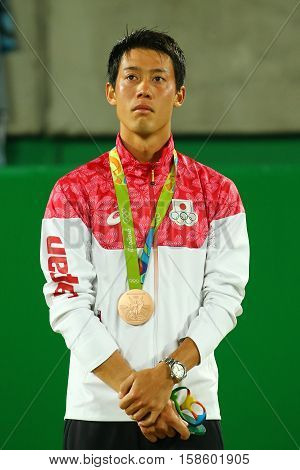 RIO DE JANEIRO, BRAZIL - AUGUST 14, 2016: Bronze medalist Kei Nishikori of Japan during tennis men's singles medal ceremony of the Rio 2016 Olympic Games at the Olympic Tennis Centre