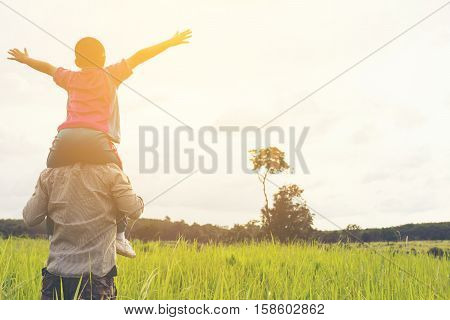 Family with mountain view,Or Father and son are happy with travel and picnic with mountain and sunshine view.1
