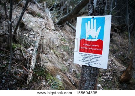 POLAND, HIGH TATRAS - JANUARY 04, 2016: A sign warning of the danger of avalanches in the High Tatras mountains.