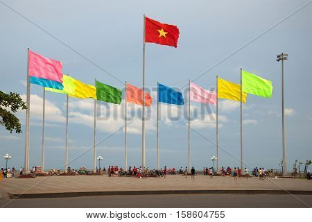 VUNG TAU, VIETNAM - DECEMBER 21, 2015: Fragment of the city's waterfront with the national state flag of Vietnam. The tourist landmark of the Vung Tau, Vietnam