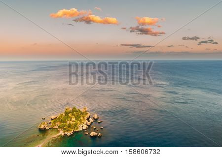 Beautiful landscape of Taormina, Italy seascape with beach and island Isola Bella. Travel photography.