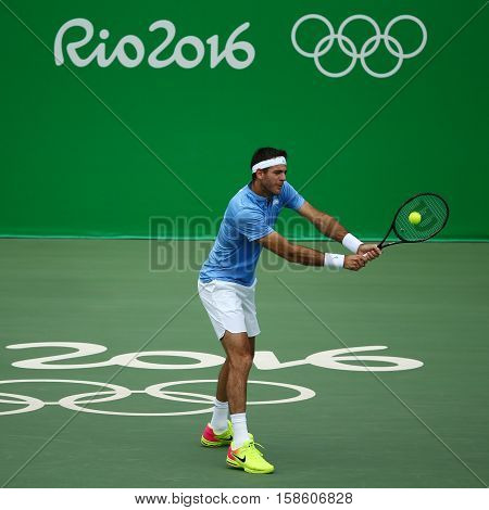 RIO DE JANEIRO, BRAZIL - AUGUST 11, 2016: Grand Slam champion Juan Martin Del Potro of Argentina in action during his quarterfinal match of the Rio 2016 Olympic Games at the Olympic Tennis Centre