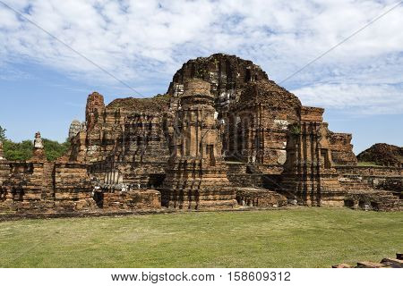 Ruins of the main prang of Wat Mahathat Temple of the Great Relic a Buddhist temple in Ayutthaya central Thailand