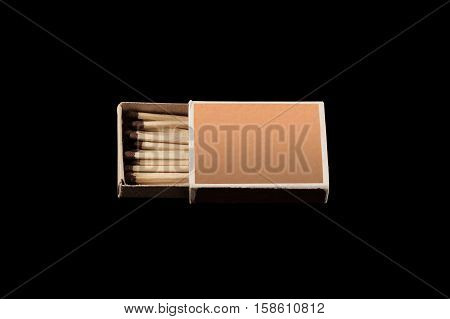 matchbox with matches isolated on a black background