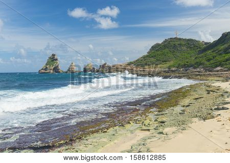 Rocks and hills  of Pointe des Chateaux, the most Eastern point of French island  of Guadeloupein the Caribbean