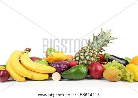Group of fresh vegetables and fruits on white background, closeup