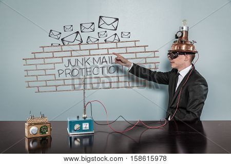Junk Mail Protection concept with vintage businessman pointing hand