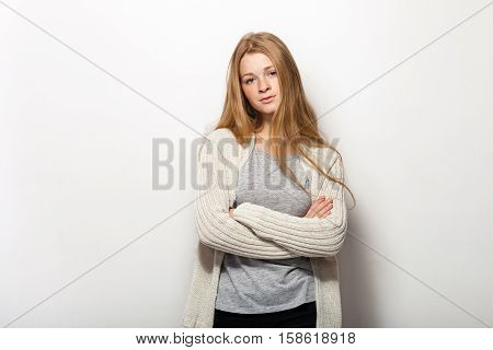 Human pose expressions and emotions. Portrait of young adorable redhead woman with gorgeous extra long hair in cozy sweetshirt looking questioningly