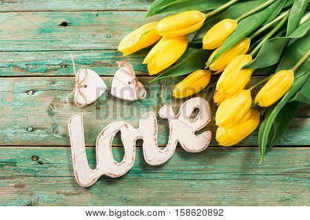 Valentines Day Background With Hearts And Yellow Tulips On Wooden Table