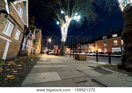 Castle Street in Farnham, Surrey, captured at twilight with the Christmas lights mounted.