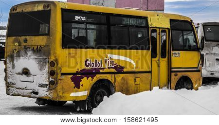 Kazakhstan, Ust-Kamenogorsk, november 13, 2016: Chinese bus Yutong at a bus stop, city bus, public bus, mini bus, short bus, old dirty bus, old bus, grunge bus