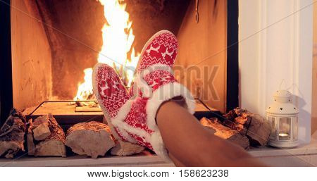 Young woman relaxing in Christmas booties