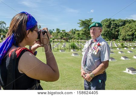 Labuan,Malaysia-Nov 11,2012:Photographer taking picture of soldier in uniform during  Remembrance Day at Commonwealth World War II in Labuan Pearl of Borneo,Malaysia.