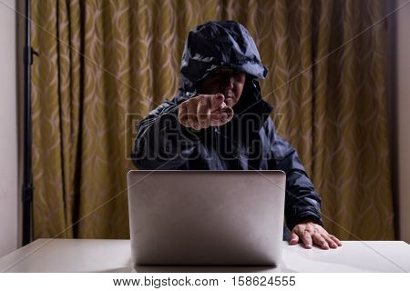 Angry Asian Hacker Pointing Finger To Audience While Hacking Network