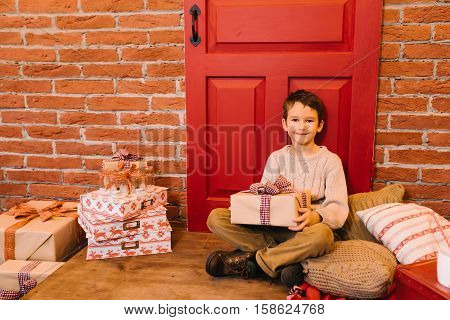 Little boy opening gift for christmas, birthday