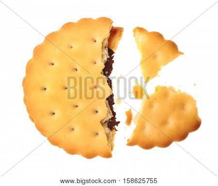 Tasty cookie with crumbs on white background