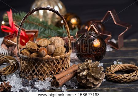 Winter christmas nuts in wicked basket with christmas decoration