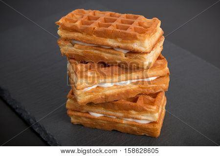 Sweet viennese waffles on a dark background