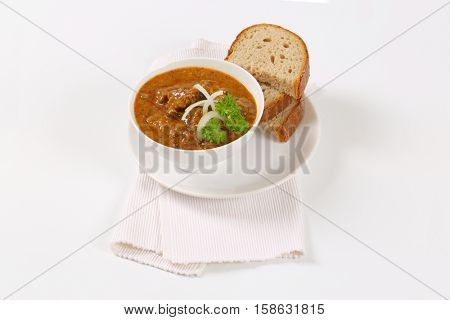 bowl of fresh beef goulash with slices of bread
