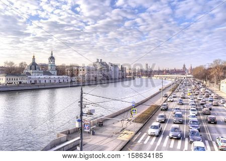 MOSCOW RUSSIA - November 22.2014: Moskva river and the road on the Moskvoretskaya Embankment of the side Kremlin