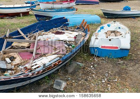 Old Wrecks of fishing sloop on Sicilian beach