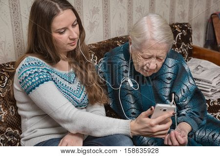 the grandmother and the granddaughter talk by video conference to relatives