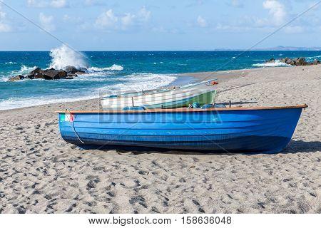 Fishing sloops at Sicilian sandy beach near Milazzo