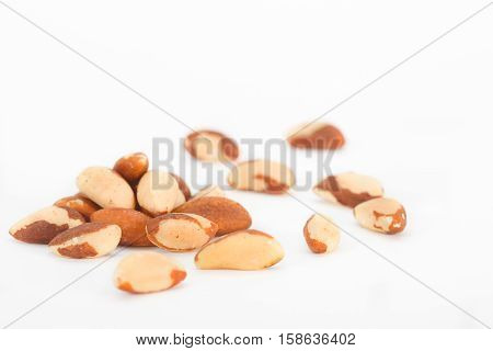 Brazil nuts on white background. Bertholletia excelsa. Healthy food.